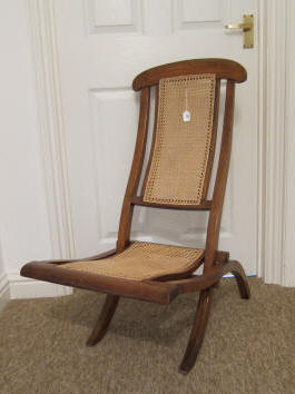 We had a growing collection of folding steamer chairs; now we just have the one following fully restored and several waiting for restoration. & Suzandy Caned Furniture Restoration